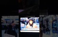 Man-taken-away-holding-mysterious-sign-in-Chinese-on-Fox-News-20-Seconds
